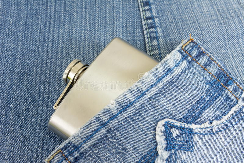 Hip flask in denim jeans pocket stock image