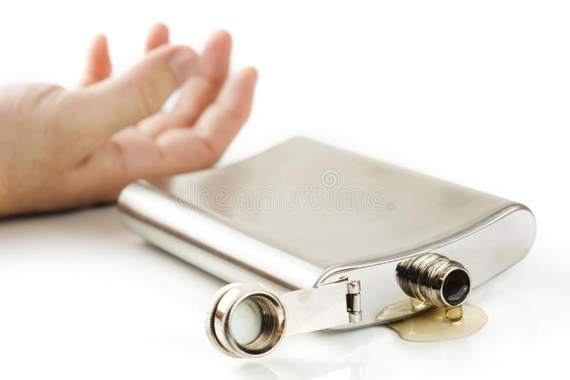 Hip flask dropping stock photography