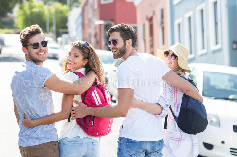 Hip friends with backpacks royalty free stock photo