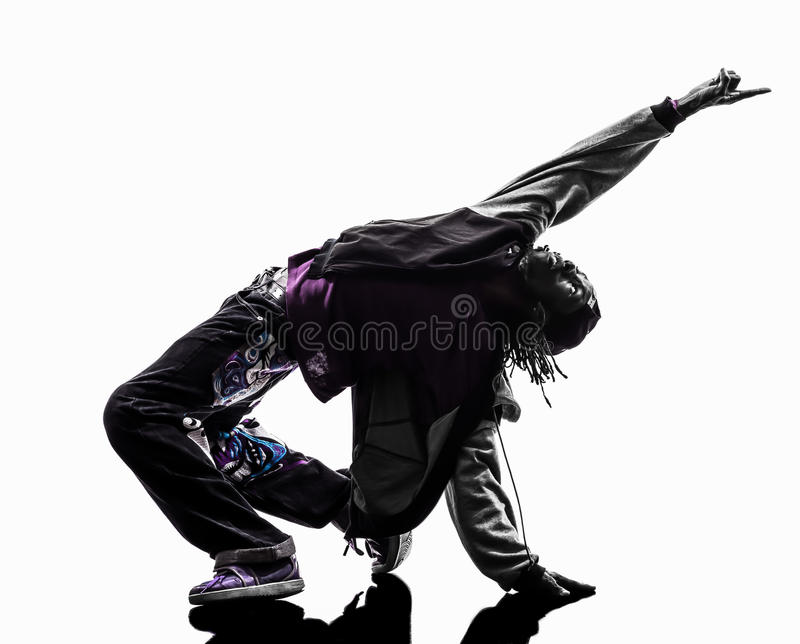 Hip hop acrobatic break dancer breakdancing young man silhouette stock photo