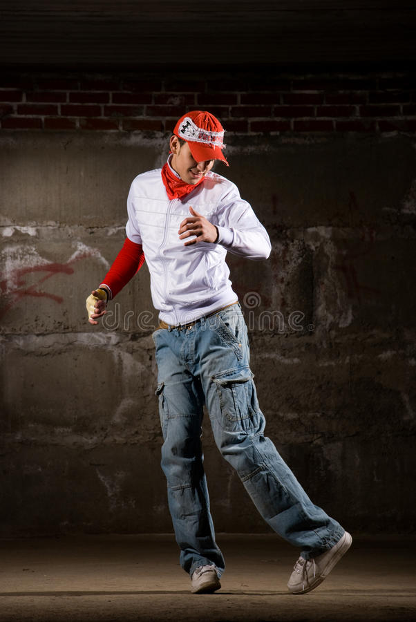 Download Hip Hop Boy Dancing In Modern Style Over Grey Wall Stock Photo - Image: 12582178
