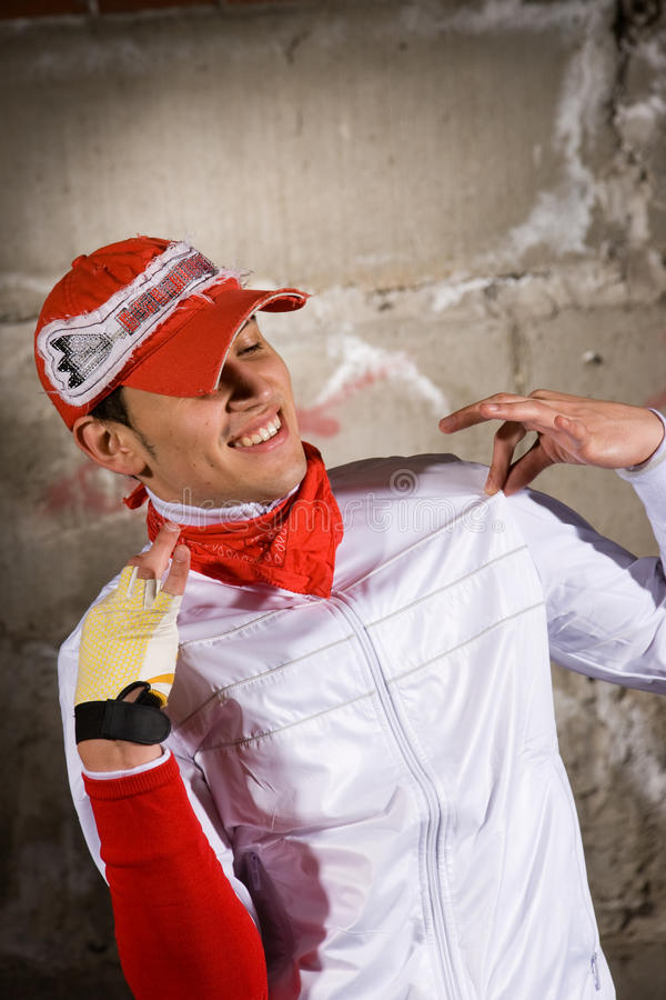 Download Hip Hop Boy Dancing In Modern Style Over Grey Wall Royalty Free Stock Images - Image: 14699419