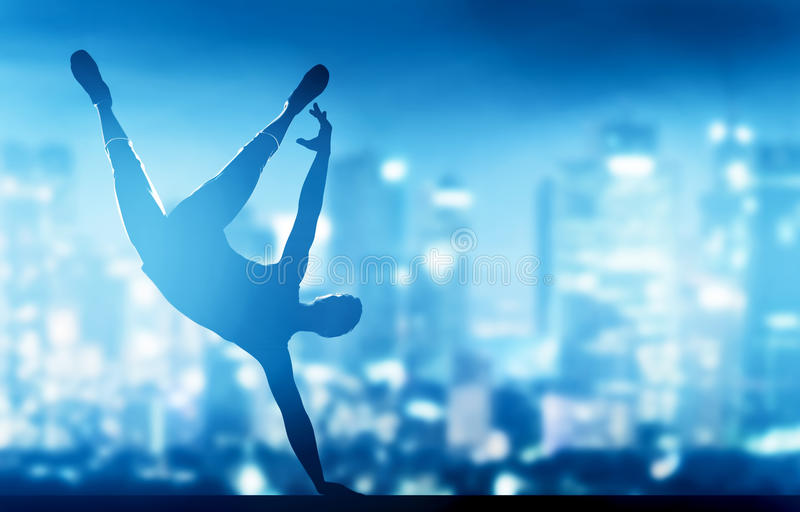 Hip hop, break dance performed by young man in city lights. Nightlife party time royalty free stock photos