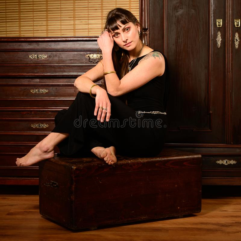 Hip hop dancer in an ancient furnitured room royalty free stock image