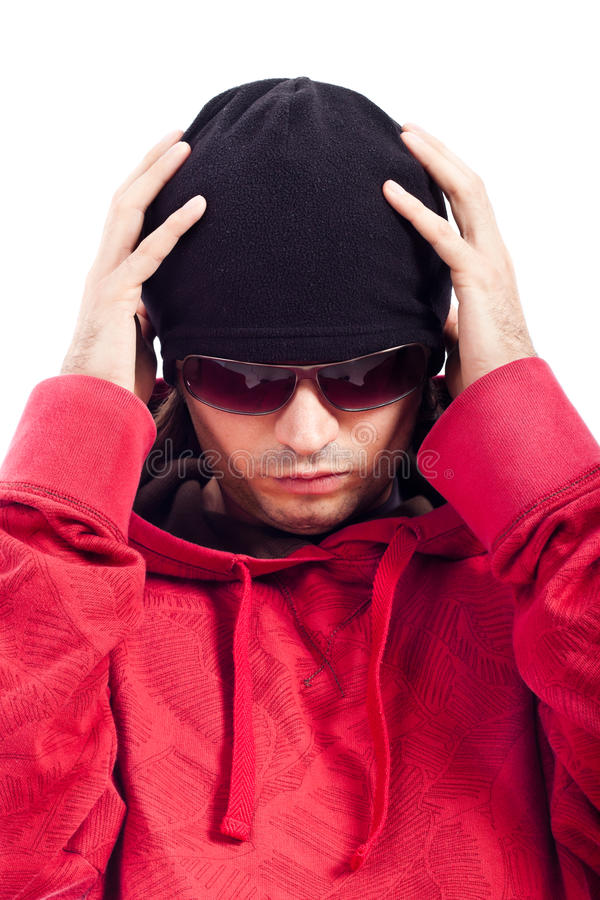 Hip Hop dancer detail. Detail of Hip Hop dancer in red hoody, black hut and sunglasses royalty free stock photo