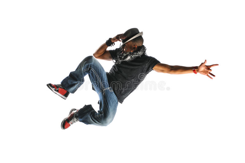 Hip Hop Dancer Jumping. Wearing a hat and isolated on a white background royalty free stock photos