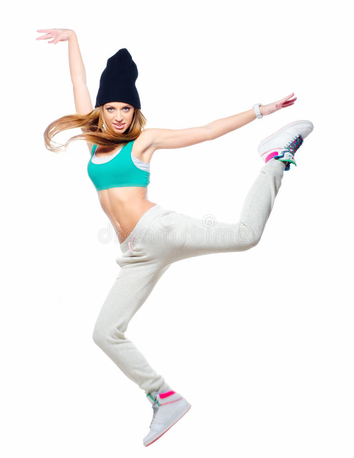 Hip hop dancer jumping high in the air isolated on white background.  royalty free stock image