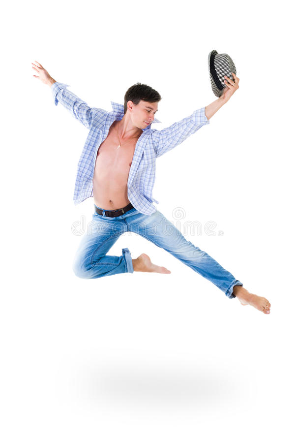 Hip hop dancer jumping over white background. Hip hop dancer jumping over isolated white background royalty free stock photo