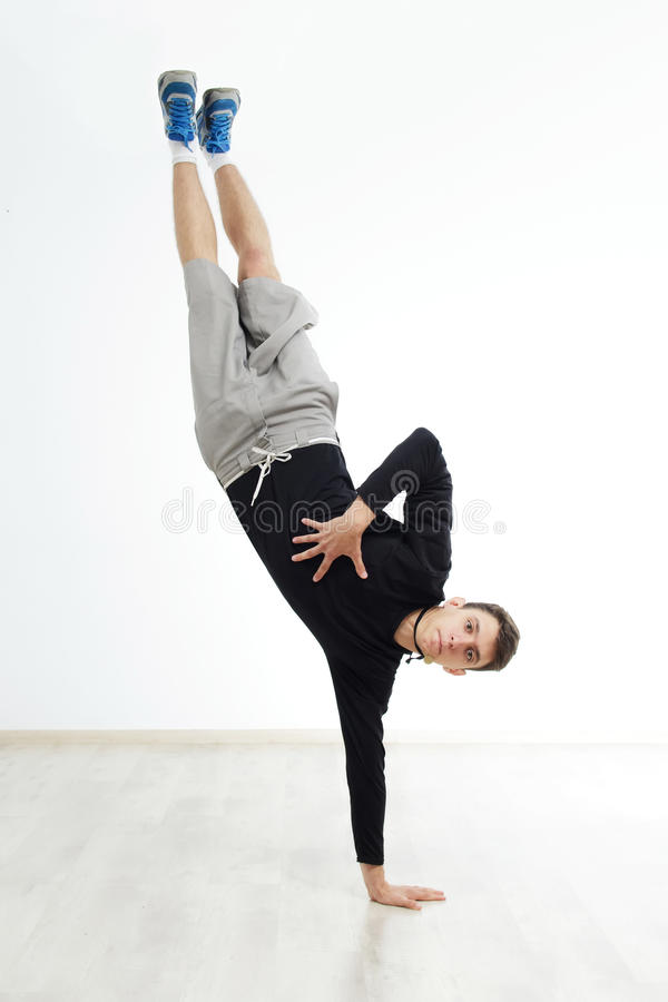 Hip hop dancer performing isolated over white background royalty free stock image