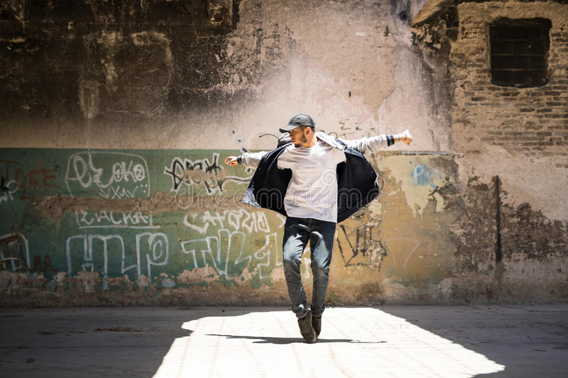 Hip hop dancer performing outdoors stock image