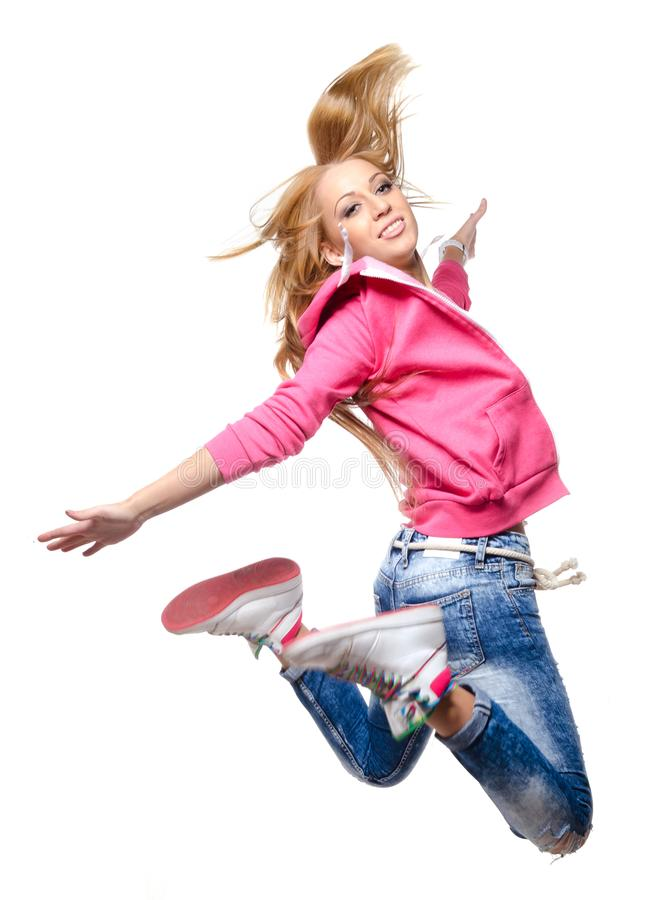 Hip hop dancer woman jumping high in the air royalty free stock photography