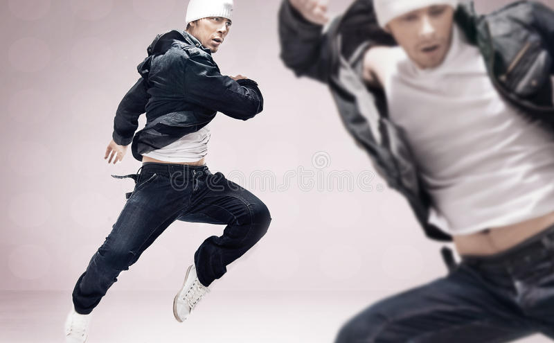 Hip-hop dancers. Handsome hip-hop dancers on ideal background royalty free stock photography