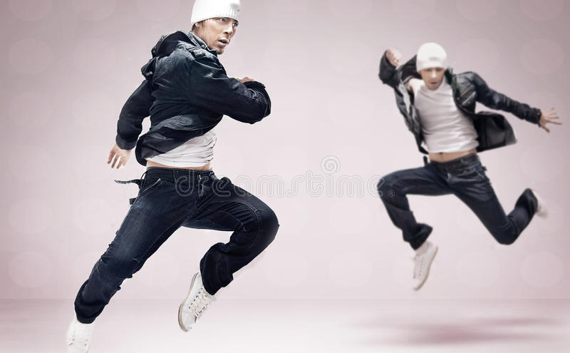 Hip-hop dancers. On ideal background stock photo