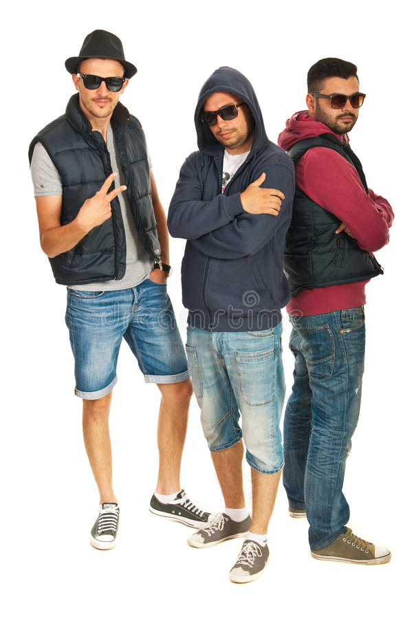 Hip hop dancers. Group of three hip hop dancers with sunglasses isolated on white background stock image