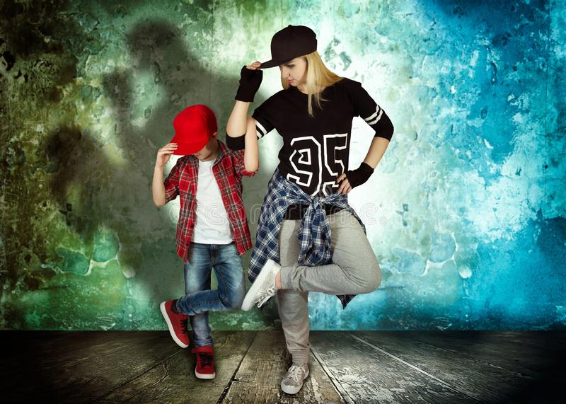 Mother and son dance hip-hop.Urban lifestyle. Hip-hop generation. stock photos