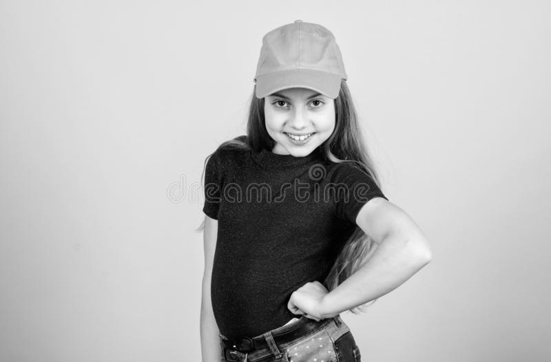 Hip hop girl. Fashionable girl child. Small girl with fashion look. Little girl with long blond hair in casual fashion. Style. Cute little fashion model, copy royalty free stock photos