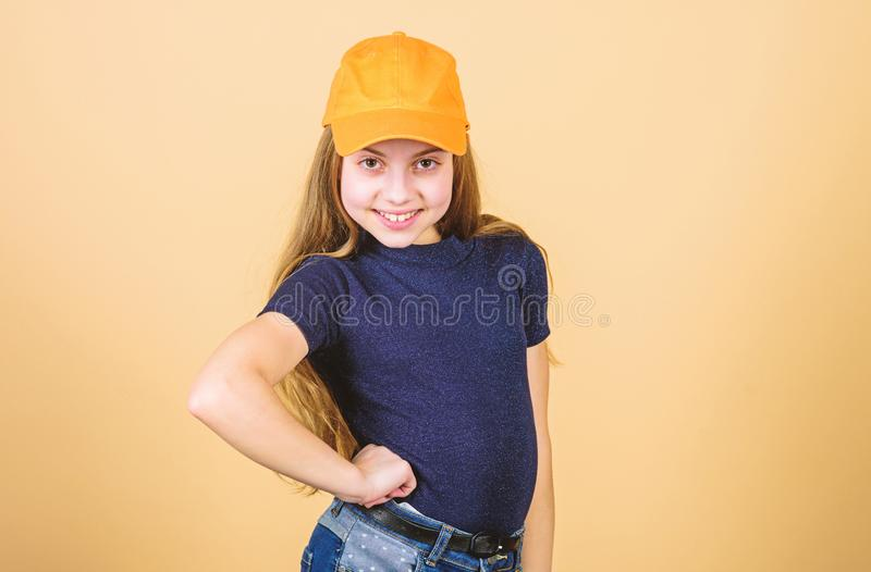 Hip hop girl. Fashionable girl child. Small girl with fashion look. Little girl with long blond hair in casual fashion stock photo