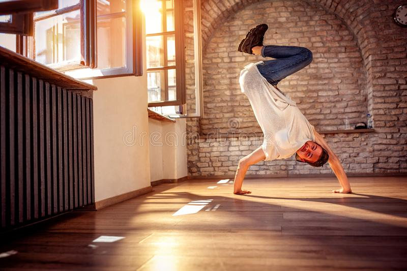 Hip hop lifestyle concept - street artist break dancing performing moves. Hip hop lifestyle concept - smiling street artist break dancing performing moves royalty free stock images