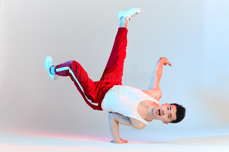 hip hop male break dancer dancing on white background royalty free stock photo
