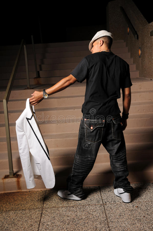 Download Hip Hop Man Holding jacket stock image. Image of earrings - 12834831