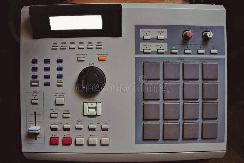 Hip hop music. Sound recording equipment.Hip hop music producer makes beat on push button production controller device.Disc jockey play beats on push pads.Media stock photo