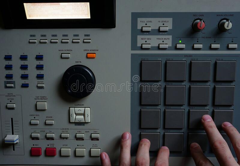 Hip hop music. Sound recording equipment.Hip hop music producer makes beat on push button production controller device.Disc jockey play beats on push pads.Media royalty free stock photography
