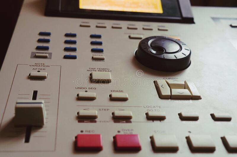 Hip hop music. Sound recording equipment.Hip hop music producer makes beat on push button production controller device.Disc jockey play beats on push pads.Media stock image