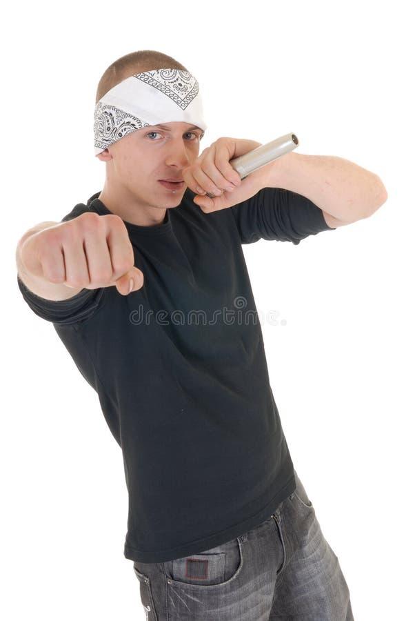 Hip hop rapper, singer. Handsome youngster, teenager hip hop, rapper singer with microphone, white background stock photo