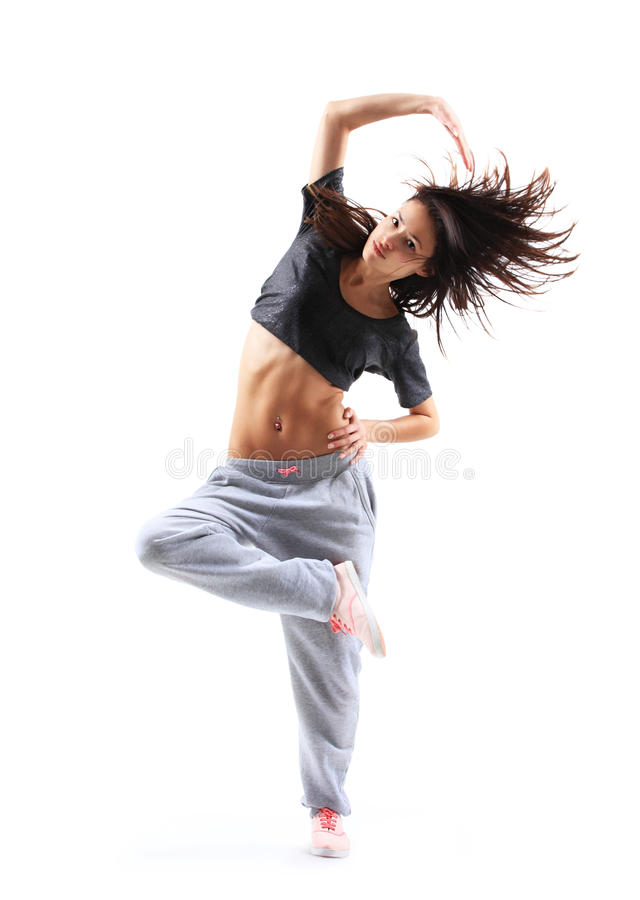 Hip-hop style teenage girl jumping dancing stock photo