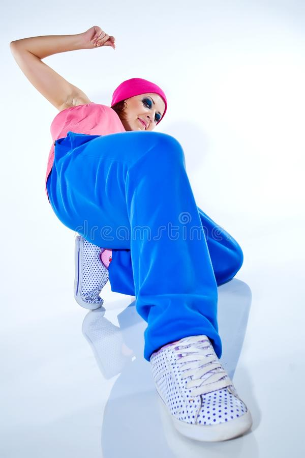 Hip-hop woman dancing in studio royalty free stock photography
