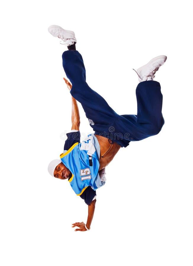 Hip-hopjunger Mann, der kühle Maßnahme auf weißem backgr trifft stockfoto