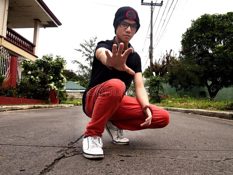 Hip male teenager. Photo of a hip male teenager out on the street royalty free stock photos