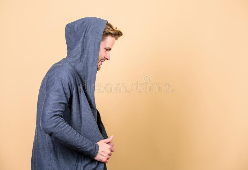 Hip and stylish. copy space. man in trendy hooded jacket. perfect look of muscular man. male fashion and beauty stock photo