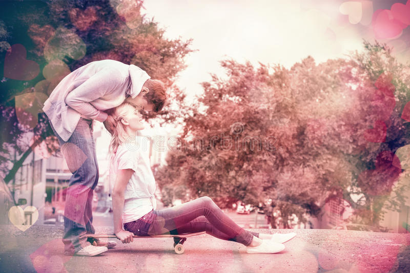Hip young blonde sitting on skateboard with boyfriend kissing forehead. On a sunny day in the city stock illustration