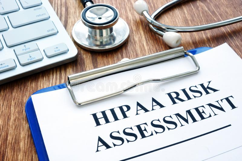 Hipaa risk assessment form and stethoscope. On a desk royalty free stock photos