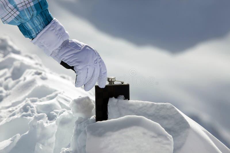 hipflask śnieg fotografia stock