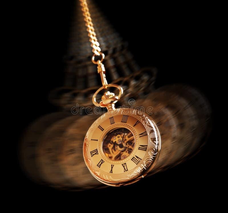 Hipnotizar el reloj de bolsillo fotos de archivo
