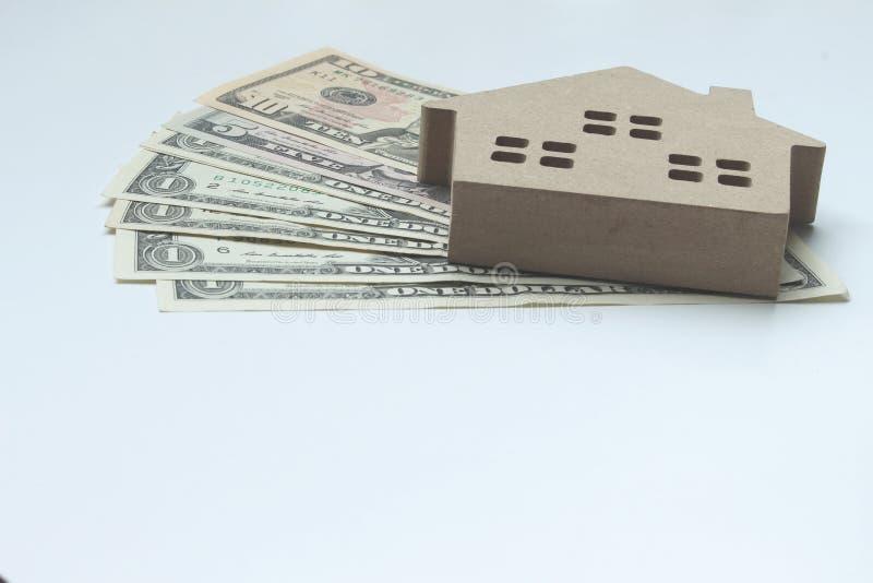 Hipoteczny ładunek i dolara pieniądze własność dla pojęcia z kopii sp zdjęcia stock