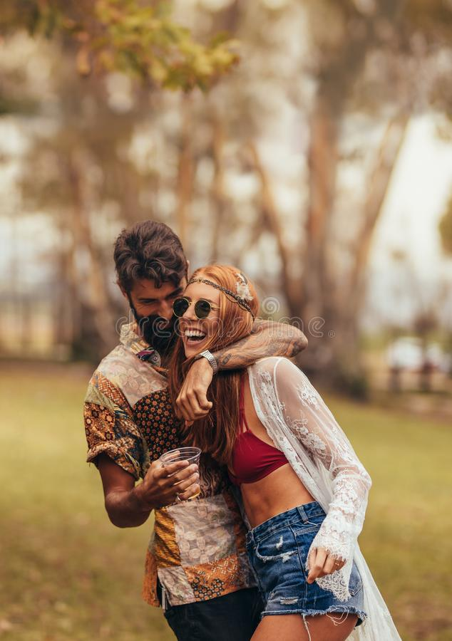 Hippie couple having fun at music festival royalty free stock photography