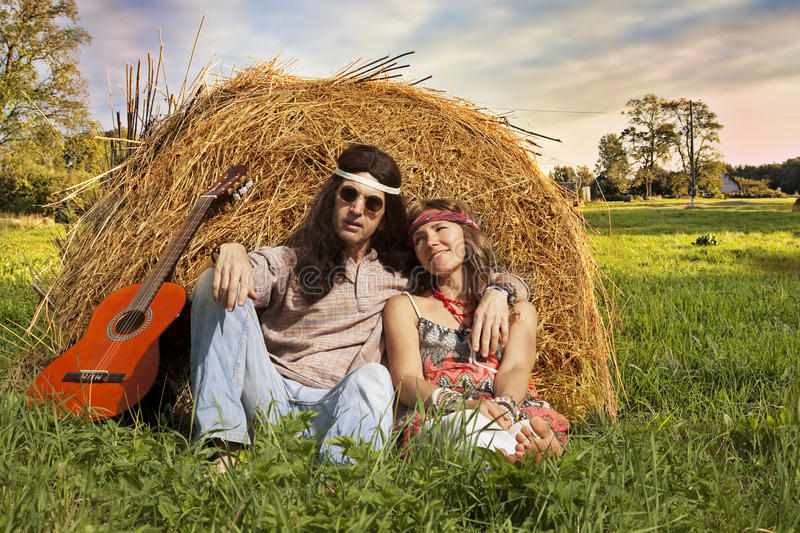 Hippie couple outdoors stock photography