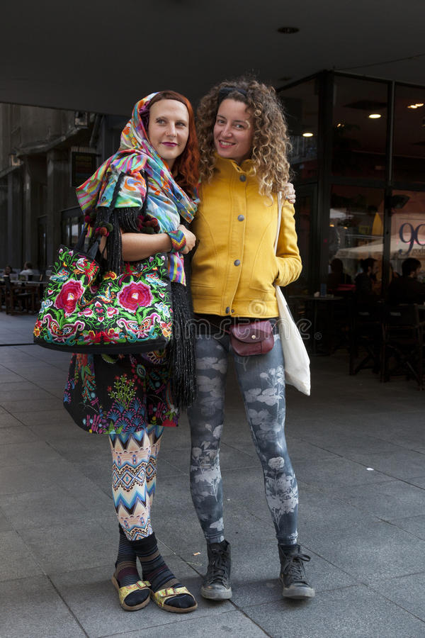 Hippie street fashion. Zagreb, Croatia. Hippie style fashion with vivid colors and flower decorations is becoming popular among young girls stock image