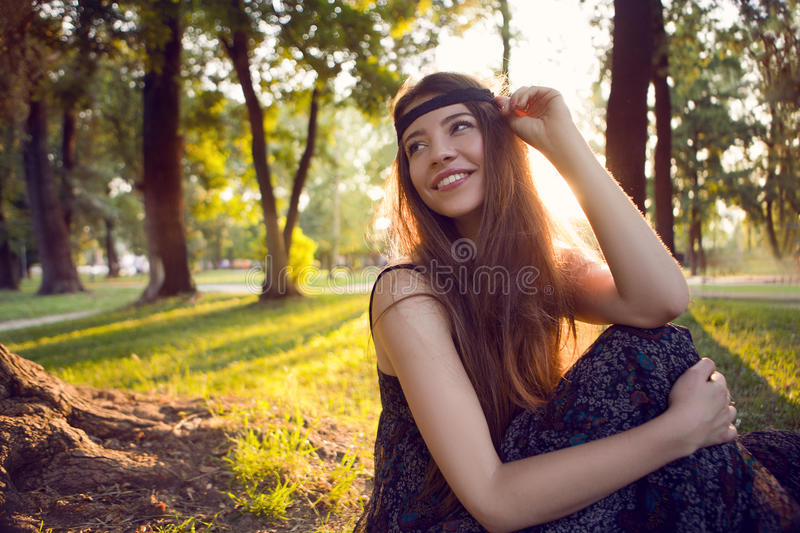 Hippie girl. Smiling in the park royalty free stock photo