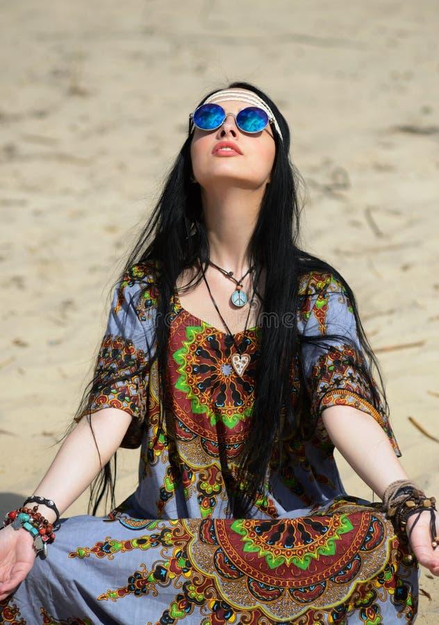Hippie girl meditates. On a beach royalty free stock photos