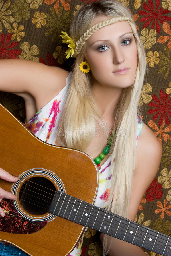 Hippie Guitar Girl. Blond hippie girl playing guitar royalty free stock photos