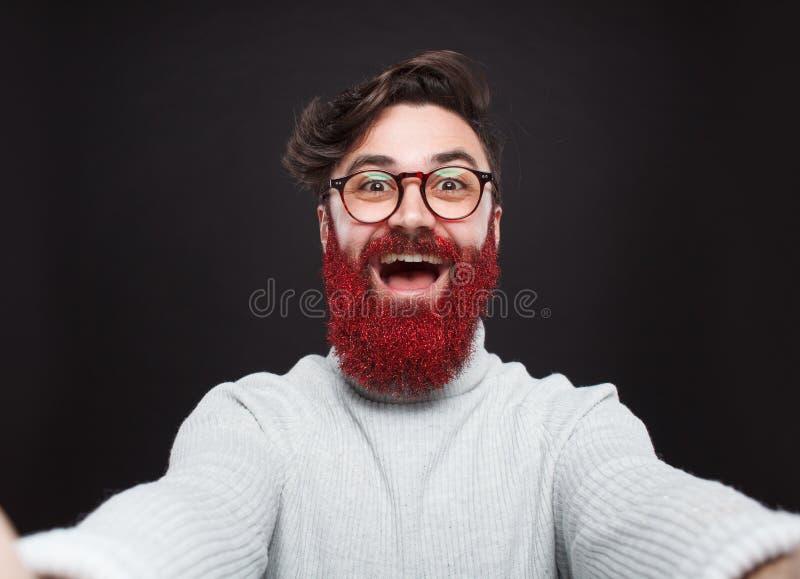 Hippie intelligent avec la barbe rouge de scintillement photo libre de droits