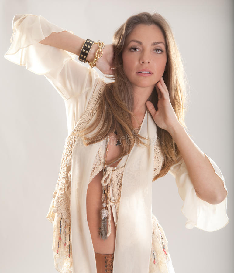 Hippie Model. An image of a pretty model in a flowing hippie outfit with vest and jewelry royalty free stock image