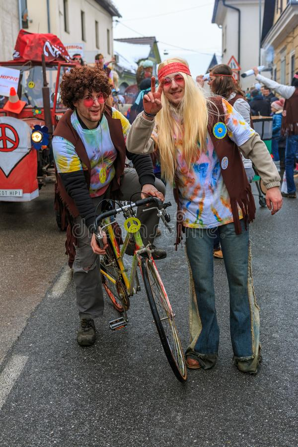 Hippie riding a bike and spreading love and peace royalty free stock image