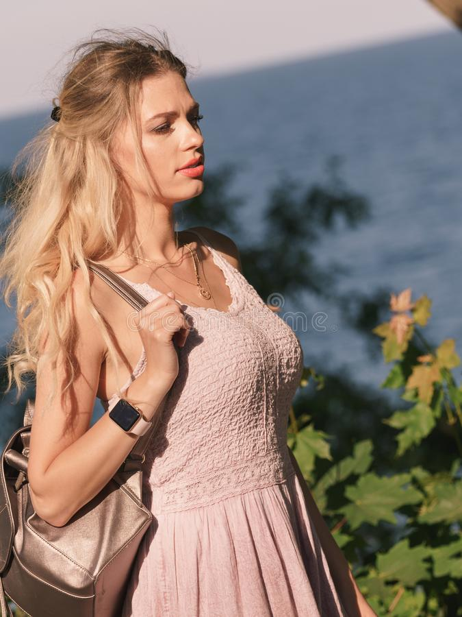Hippie woman with backpack walking outdoor royalty free stock photo