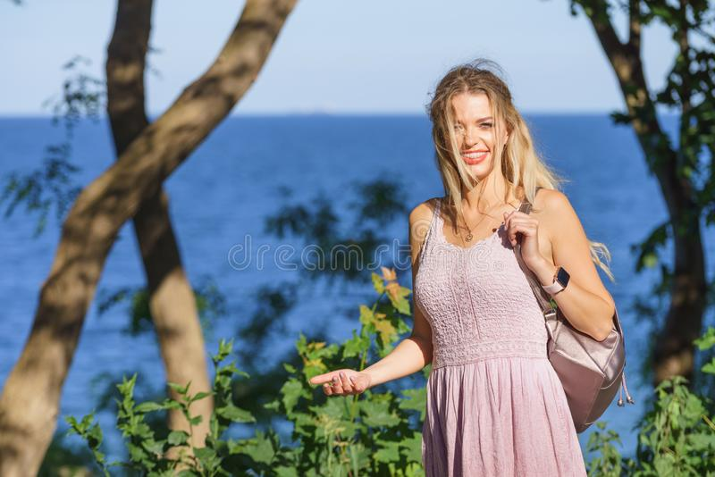 Hippie woman with backpack walking outdoor stock photo