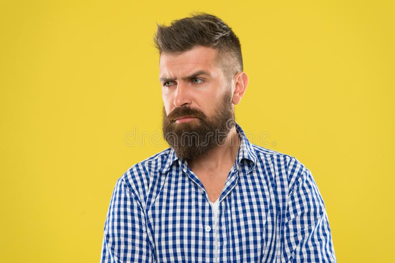 Hipster appearance. Beard fashion and barber concept. Man bearded rustic hipster stylish beard yellow background. Barber royalty free stock photos